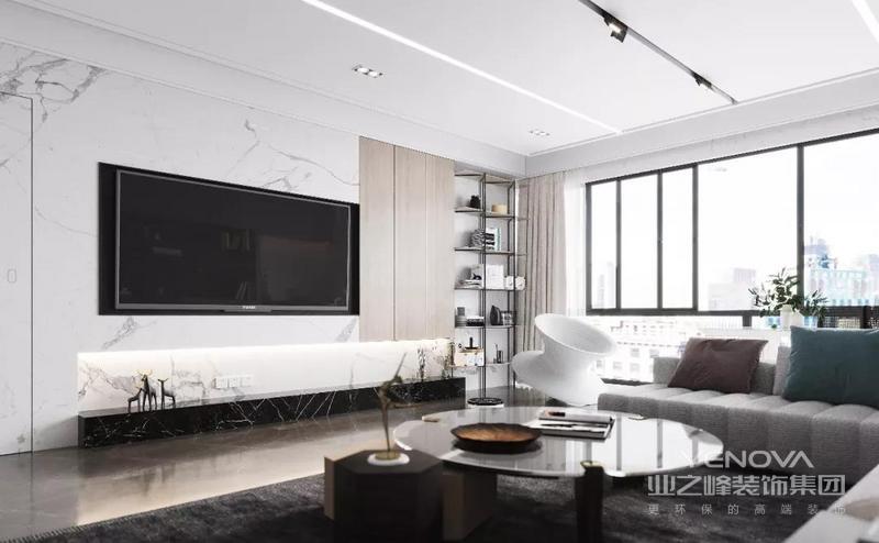 电视背景墙结合了黑白颜色的石材、木饰面,融入灯带的光源使背景墙的层次更加多元化。