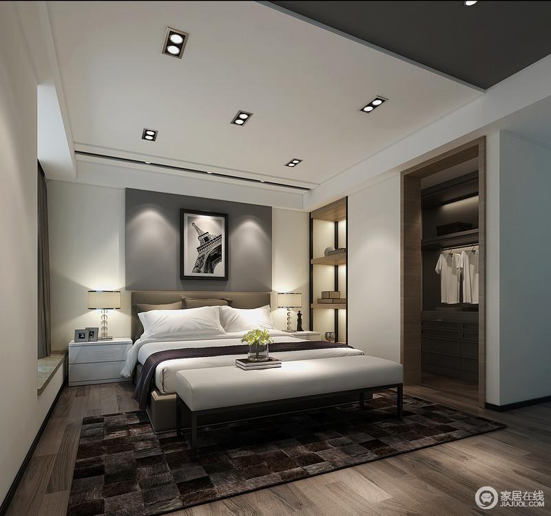 卧室没有太多造作的形式,灰色床头背景处的铁塔摄影作品冷峻而真实地记录着生活的点滴,木架上的艺术品更添简约;对称式白色家具与床品在深灰色几何地毯的反衬中,清晰地展现深浅,愈加得体。