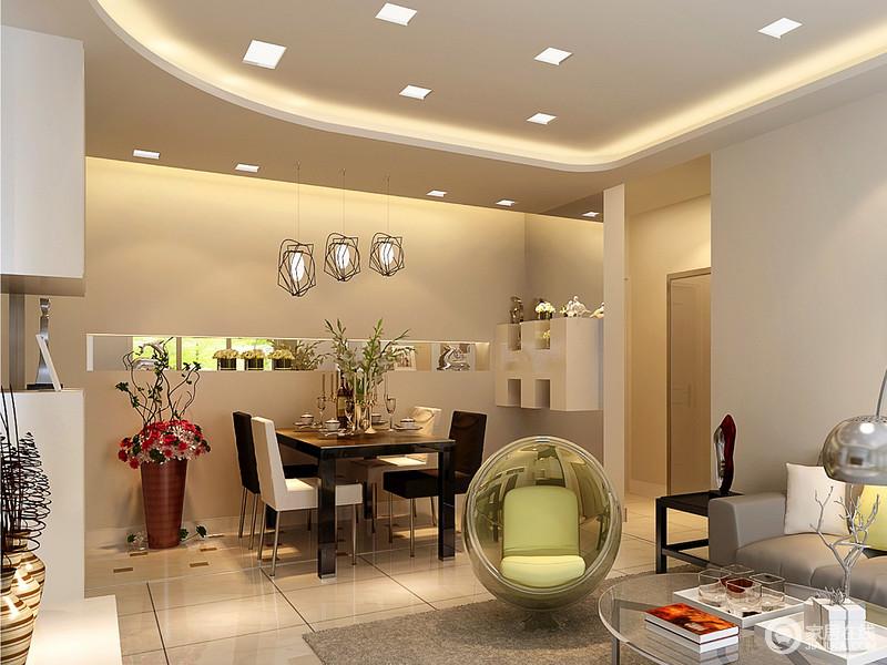 餐厅位于入户门口,加入一道墙作为私密隔断,与背景墙共同饰以镜面扩大视觉。天花的灯带营造浮光略影,映照着黑白搭配的餐桌椅,在装饰的点缀下,小巧玲珑间透着情调。