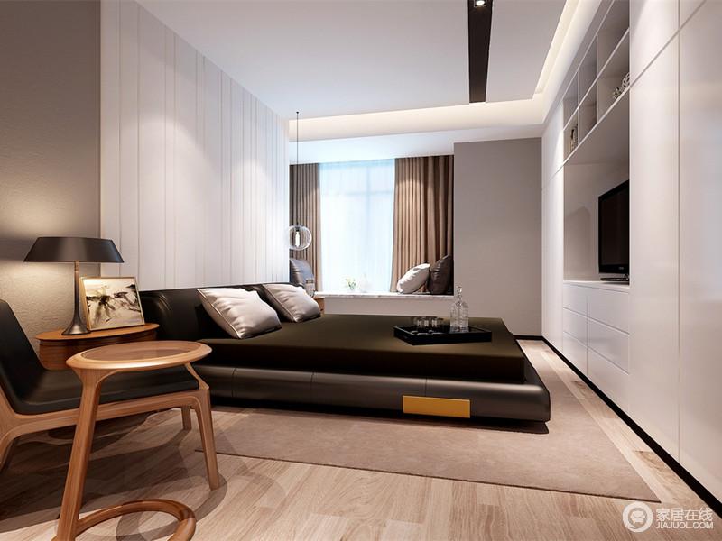 卧室里白色装饰的床头墙面与内置环形储物柜设计制造视觉上的平衡。双人床则以深色系与墙面的浅色碰撞,简洁内敛的空间呈现出硬朗的雅致气质。