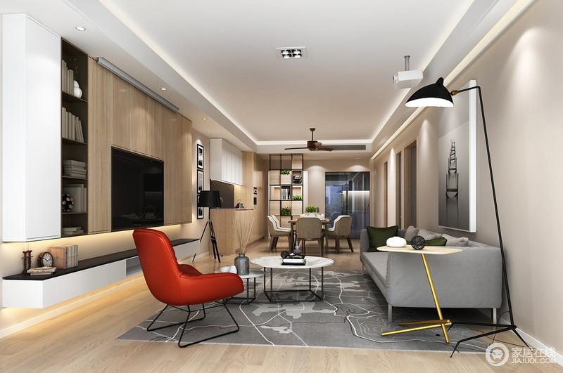 开放式的设计有条不紊地展示着功能性,灰色沙发在红色单椅和黑色台灯、工业感圆几的点缀中现代时尚;灰色调的简画和灰色地毯素雅而趣味生动,悬挂柜以黑白木为组合,实用而整洁,轻快而温实。