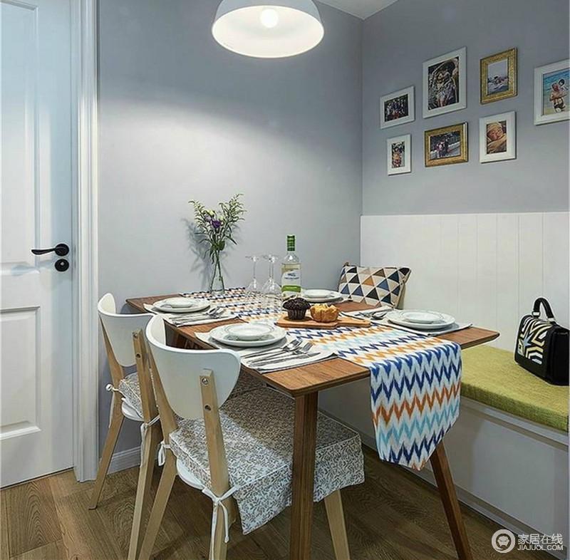 餐厅利用空间一隅打造,加入的卡座既能营造气氛,又能增加储物空间。棕木与原木色的餐桌椅上,铺展的几何桌布及碎花坐垫,增添了浪漫的就餐氛围。