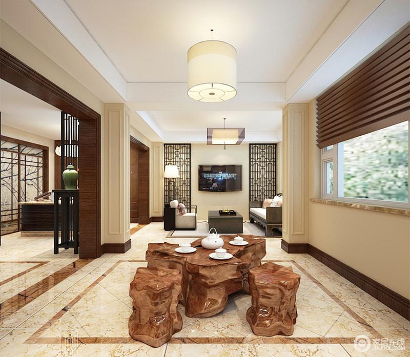 阔朗的休闲区域里设计师将一方自然雕琢的茶台及根雕置于其中,开放式的空间使氤氲的茶香溢满四方,空间里的中式装饰,安静寂然的彰显出悠闲与自得。