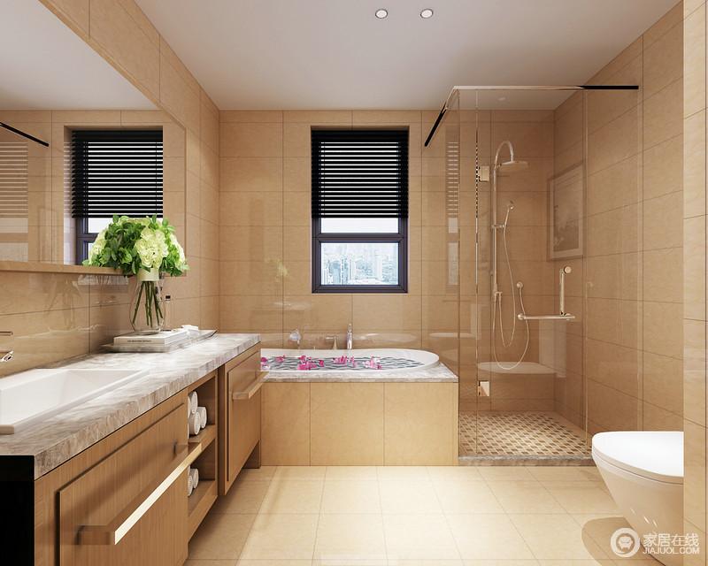 卫浴间十分规整,米黄色的地砖带着色彩与质感令空间更具明快,硬朗的大理石制造成浴缸,与玻璃淋浴房以干湿分区的设计,尤为人性和实用;木调烤漆板盥洗台简洁凝练,与大理石台面构成现代质感。