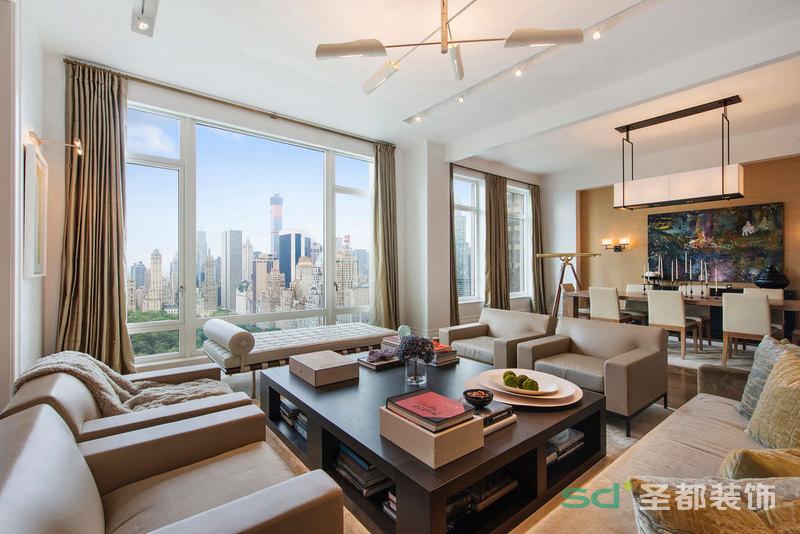 客厅大气的落地窗把空间衬托得明亮,空间感大方,沙发围绕茶几,闲时自在,怡然自乐。简单的吊顶流通了个性的规划。