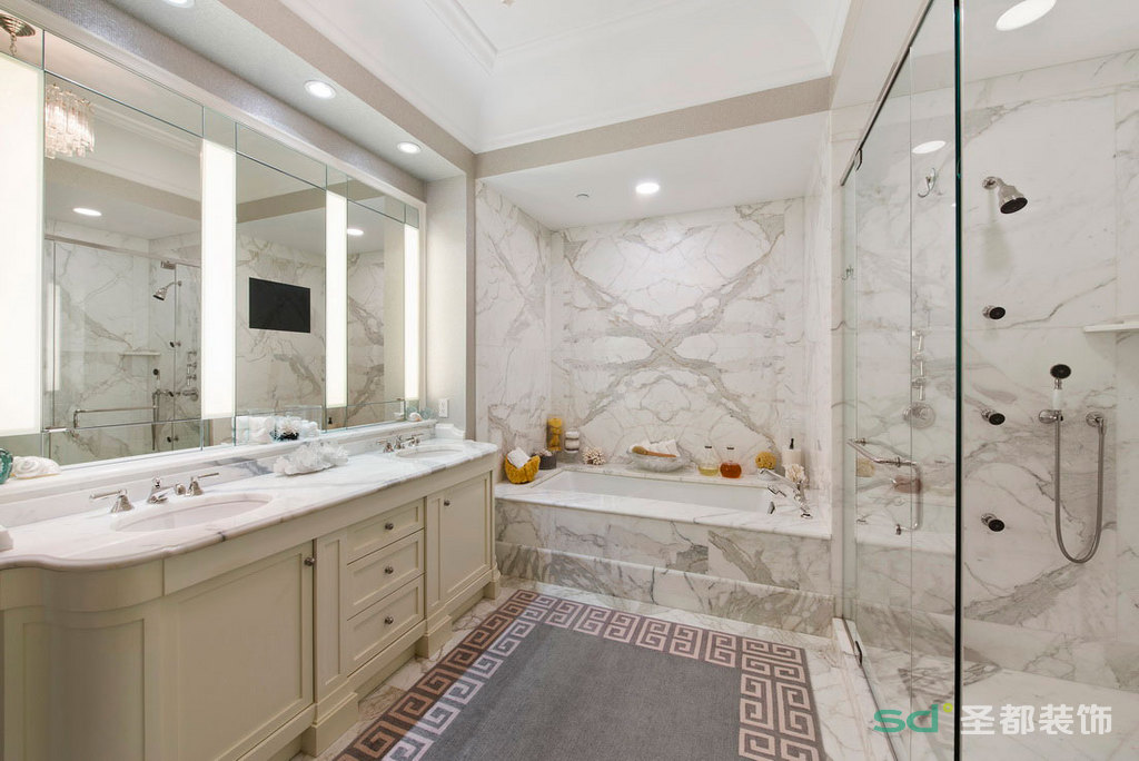 卫生间干湿分离,墙面采用大理石装饰,搭配米色系的梳洗台,简单干净。