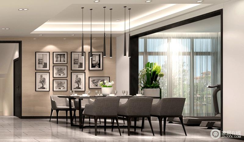 餐厅以照片墙为装饰背景,黑白色调延续了客厅的情调外,也与餐桌椅极其搭调。灰黑的沉稳配色,彰显出成熟质感。空间通过垭口与休闲室相连,宽大的落地窗带来盈盈日光。