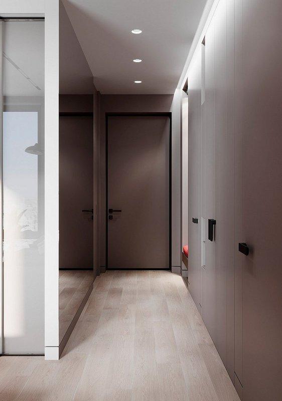 玄關一旁的鏡墻擴大了視覺面積  上方的一排頂棚燈簡約大方