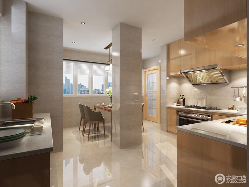 开放式餐厨空间颇为前卫,没有了空间的限制,生活愈加自由;大理石反射的光线与实木橱柜将光线与色彩交织在一起,令空间愈加明亮。