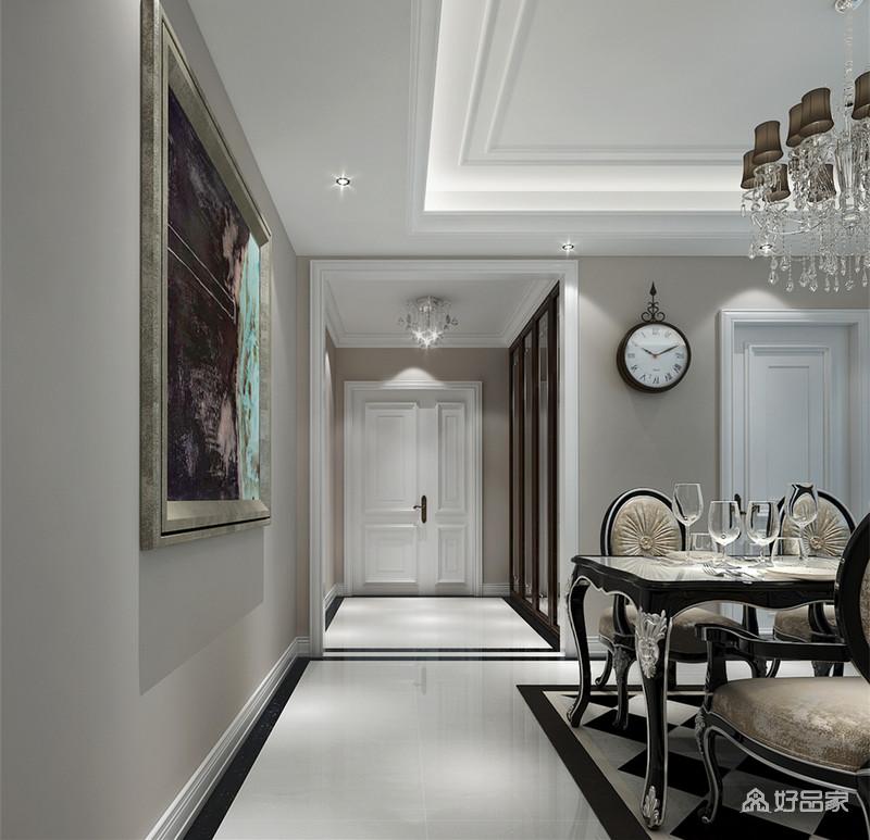 走廊的动线空间非常的明晰,玄关一侧装饰了镜面柜,扩大了玄关视觉效果,及出入时仪容的整理;装饰的挂画色调深沉,与餐厅色调相近,抽象的艺术感溢满空间。
