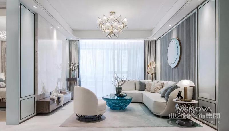 客厅在浪漫简洁的空间基础下,以淡雅的中式细节与线条,营造出一个舒适温馨的气质空间感。大理石电视背景墙,搭配木质电视柜,整体设计清爽优雅好大气。
