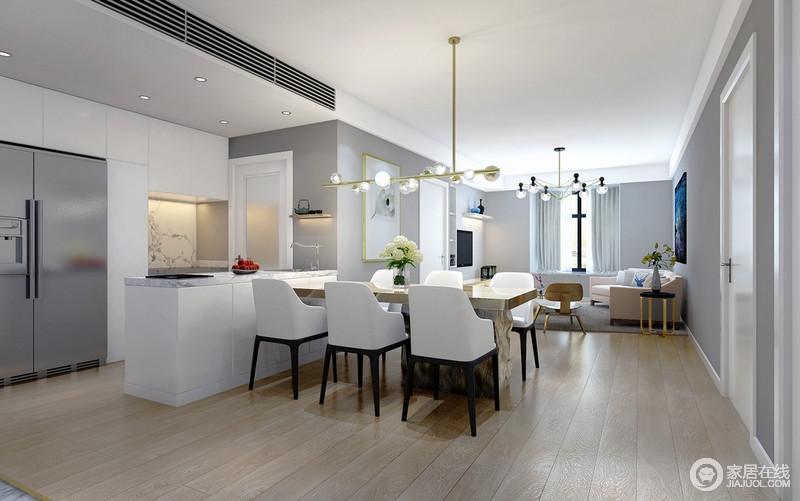 餐厅区设计师为了简单灰色沉闷,利用原木地板来暖化空间;开放式的餐厨空间通过白色岛台进行区分,电器被嵌入墙体,白色餐椅与黄铜球泡吊灯以时髦的搭配具有无限的张力。