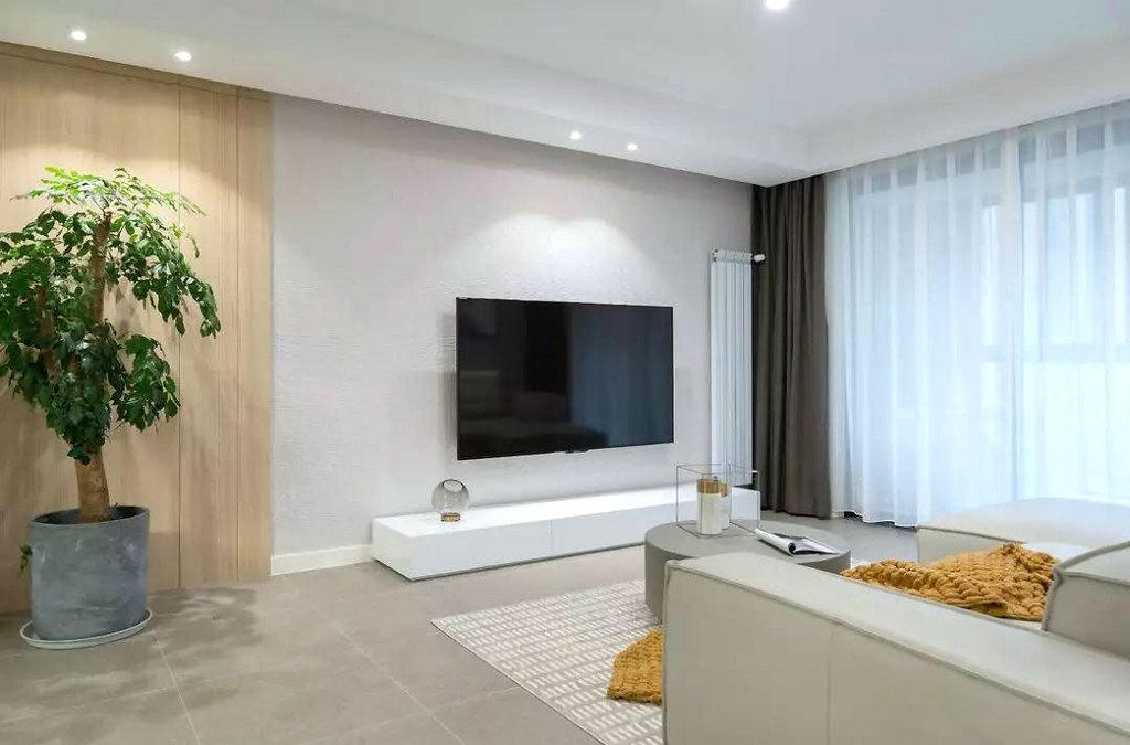 客厅空间以简约为主,没有过多装饰,在浅色系里加入原木与绿植,自然惬意。