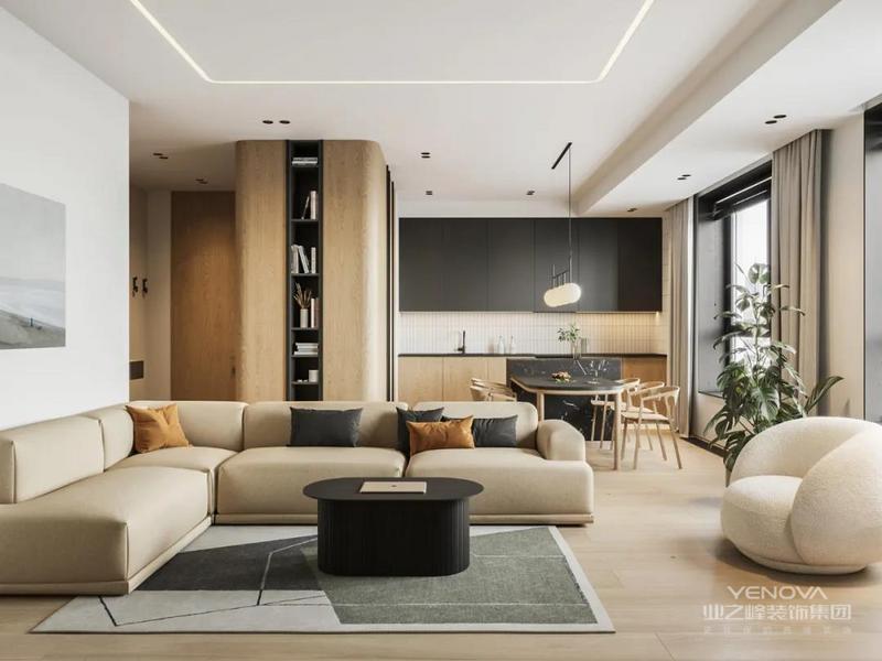 客厅同样大量的使用木元素 设计师还选择了一款与木色接近的沙发 以起到色调统一的效果 加上黑色的茶几、几何图案的地毯、绿植点缀 给人带来简约素雅的温馨感