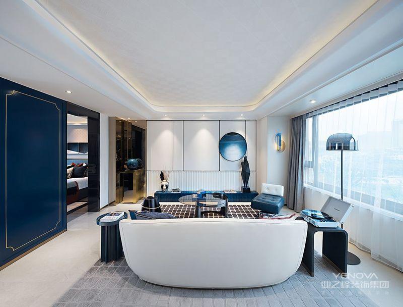 餐厅与客厅用同一块地毯进行连接,色块的渐变起到了放大空间的视觉效果