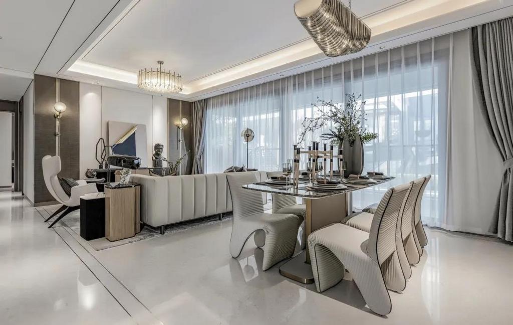 餐厅与客厅以横厅的格局,摆上大理石台面的餐桌,搭配皮质的餐椅摆设,让用餐空间显得情趣舒适而优雅自然。