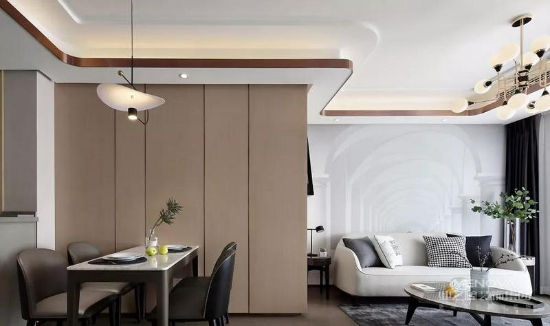 餐厅与客厅之间通过分色将两个区域很好的划分开,大理石餐桌面配上亭亭玉立的沙朗椅,整体现代而不凌厉。