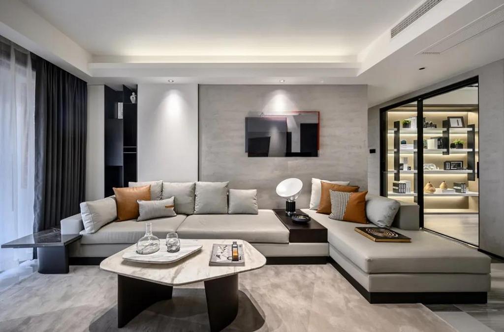 沙发墙在灰色的墙基础,挂上一幅立体抽象画面的装饰画,搭配上灰色皮沙发,整体华丽现代的软装布置,让空间充满现代舒适的自然气息。