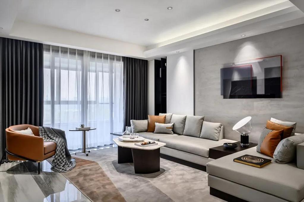 客厅电视墙以灰色大理石材质的设计,还装上一个灰色大理石地台,也让空间显得更加优雅端庄。