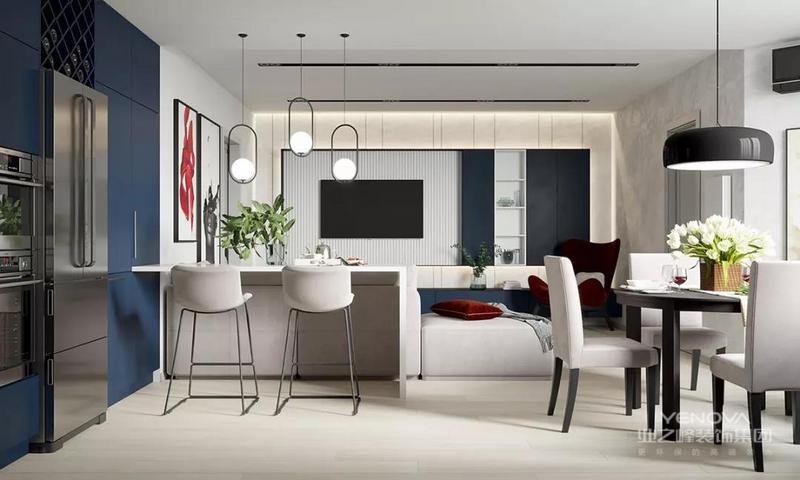 客厅空间的点睛之笔是一把深红色的椅子,它在蓝色电视柜的衬托下,成为一个充满时尚张力的休闲之处