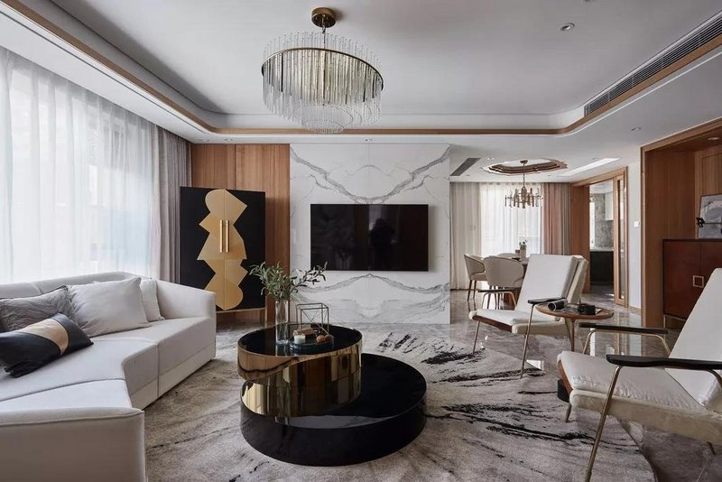 公共区域采用富有自然肌理的实木元素,搭配极具奢华感的石材、新颖时尚的现代家具及配饰,使自然与奢华这两种不同的气质得以共生,为整个居室带来丰富的层次感。