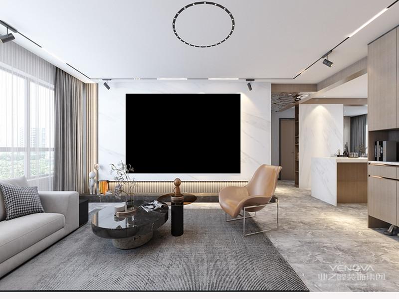 极简是一种艺术,当极简与意式风格相碰撞,呈现出一种低调与尊贵的生活方式。客厅中实木的硬和沙发的软,平衡了优雅与简约的实际需求。既高级又耐看的灰色木纹整木装饰护墙,在设计上使用了简单而精美的技巧,营造的气氛完美的契合了极简主义的风格,质感油然而生。