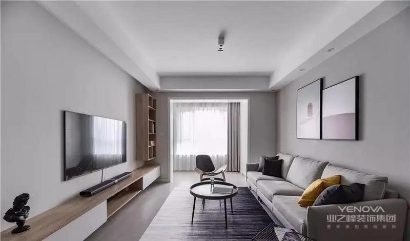 客厅空间采用无主灯设计,极简的顶面在中央位置明装射灯,可自由调节照射角度。