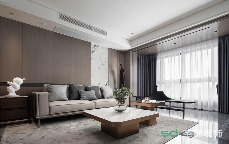 打通陽臺,不僅讓客廳擁有了超棒的采光,還增加了室內的活動空間。金色的陽光投射進來,給氣質灰和溫柔咖的主色調蒙上一層淡淡的柔光,愈加顯出客廳的優雅與溫馨。