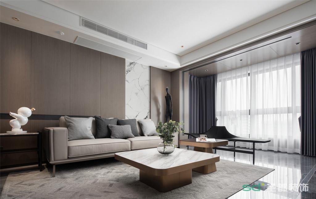打通阳台,不仅让客厅拥有了超棒的采光,还增加了室内的活动空间。金色的阳光投射进来,给气质灰和温柔咖的主色调蒙上一层淡淡的柔光,愈加显出客厅的优雅与温馨。
