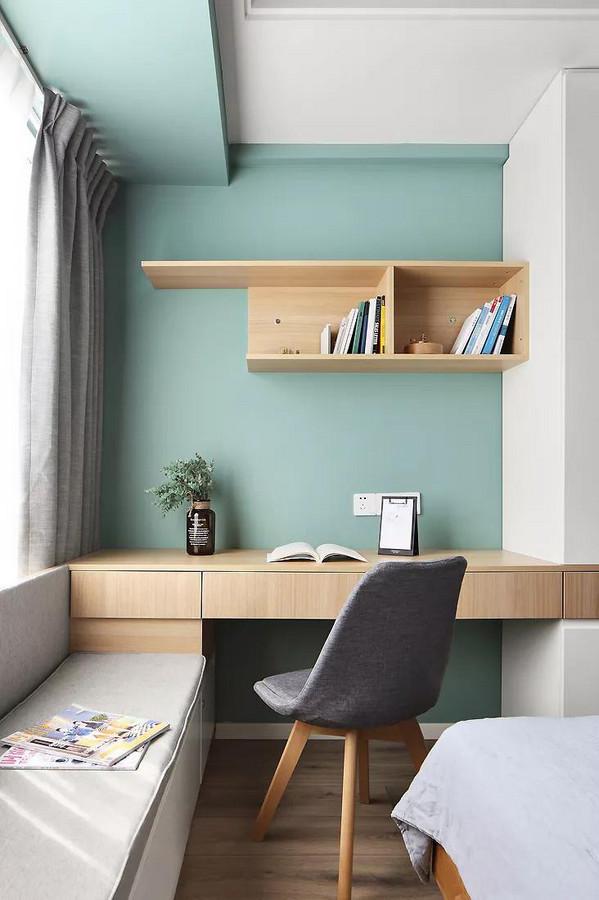 衣柜、书桌、卡座连成一体的设计,节约空间的同时也让视觉上更加规整。