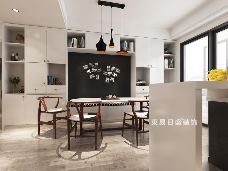 桂林冠泰•城国二居室145㎡简约风格:餐厅装修设计效果图,原本餐厅不是很大,又想要一组装饰柜来加强空间的储物收纳功能,所以设计师将白色收纳柜嵌入墙体,呈几何之美,与和摆放的装饰品,构成陈列艺术;黑板墙、黑色吊灯陪衬着构成色彩反差,让空间多了抽象艺术,而实木家具的新中式简约,点缀出温实大气。
