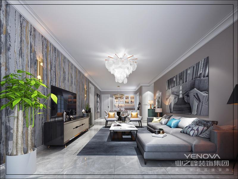 客厅的色调在灰白基础上,通过电视背景的灰色点缀,让空间的层次得到不一样的呈现。