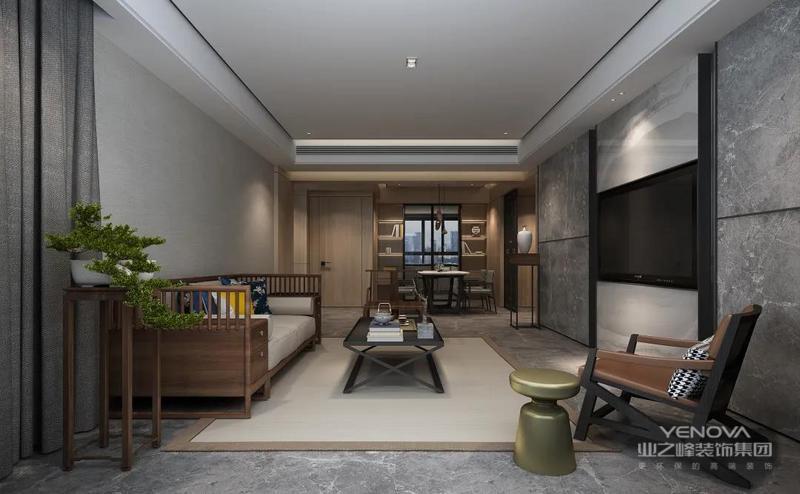 客厅保持简洁高级的黑白灰空间基调,在无主灯的空间氛围下,布置上新中式的家具,营造出一种极简端庄的高级空间感。