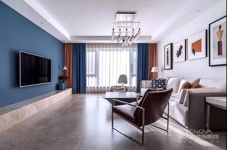 客厅以年轻的现代简约风格基础搭配,蓝色电视墙搭配硬装砌的电视柜台面,以壁挂的电视机,整体显得格外的简约大方。