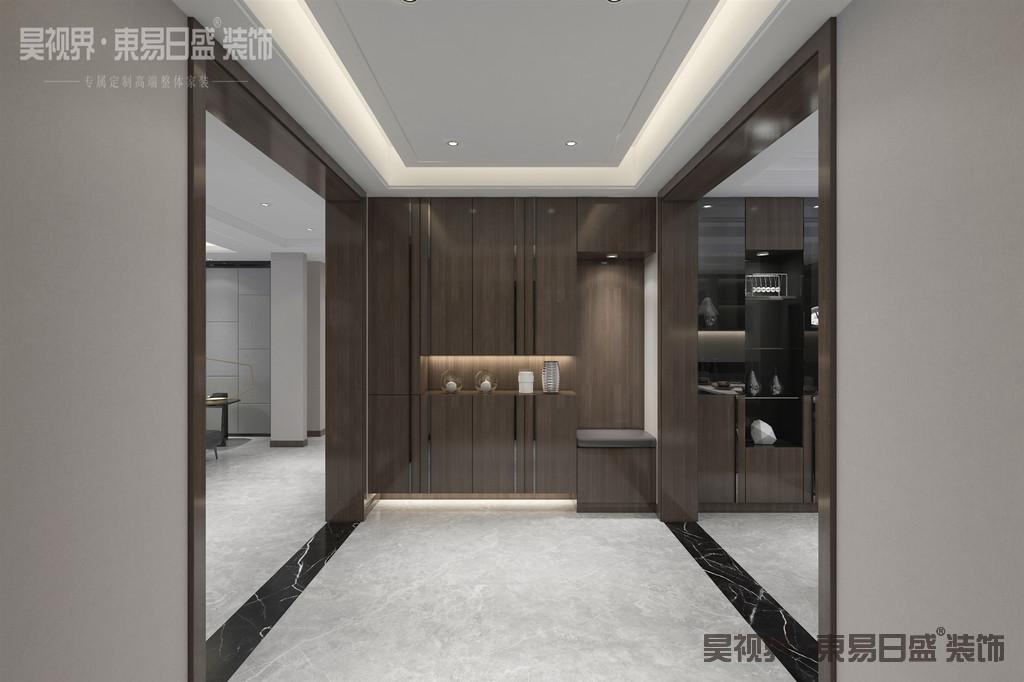 推门而入,是一个独立空间的玄关, 简约俐落的质材铺叙与敞明大方的格局尺度,是现代风定调的设计居宅中,不可或缺的重要元素。