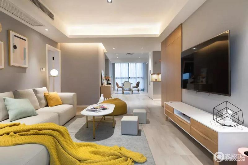 整个空间的墙面以经典浅灰色调呈现静雅,沙发茶几和电视柜作为中和色调起到巧妙地过渡,而抱枕、懒人沙发、明黄色的盖毯,与金属射灯一样,将整个客厅的温馨感提升到极致。