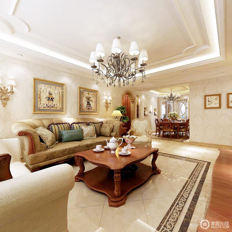 客厅通过简式欧式线条装饰吊顶,搭配米色地砖和驼色复古风的家具,成就空间的温馨;挂画装饰整个空间的墙面,点缀出生活的艺术气息,正如壁灯彰显华贵,都让生活更富品味。
