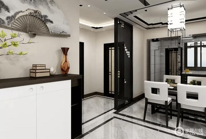 餐厅借隔断将空间明显划分开,区域感强烈;浅驼色漆粉刷地墙面,与黑白色调的餐桌餐椅,表达新中式时尚。