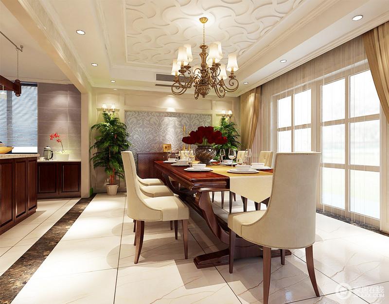 餐厅与厨房通过门框和动线分割,极具互动性,大岛台的设计给生活带来了极大的实用;石膏吊顶的曲线文脉与灰色马赛克墙面呼应,赋予空间复古美学,而新古典铆钉餐椅搭配实木餐桌、金属吊灯,无疑,营造出了生活的小奢贵;驼黄色窗帘和白色纱幔又制造着些许浪漫,柔和之中,成就生活的温馨。