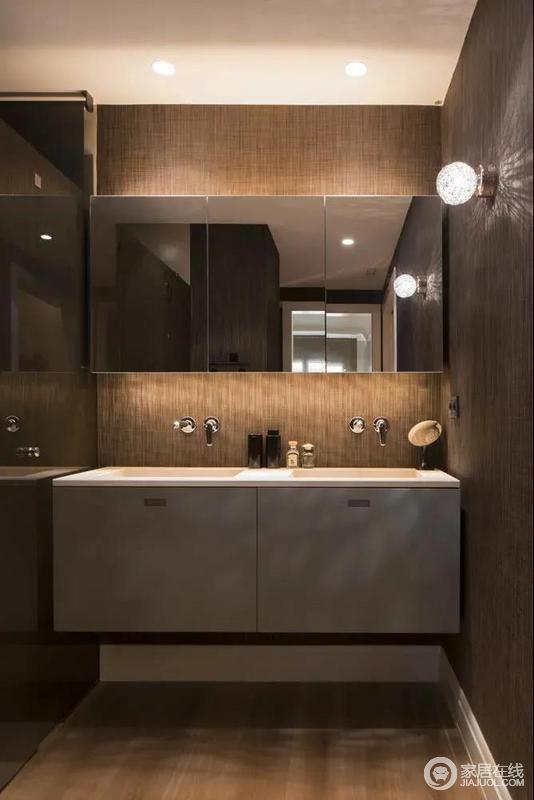 卫生间的洗手盆区域,墙面是独特的纹理质感,装饰洗手盆+浴室镜柜组合,还有均匀的灯光分布,让空间充满温馨的舒适感。