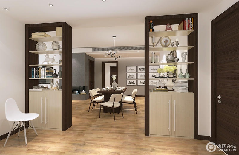 门厅和餐厅通过收纳边柜来简单区分空间,对称出了和谐,让两个空间之间形成些许互动;再加上装饰品的陈列,让空间具有浓重的生活气息。
