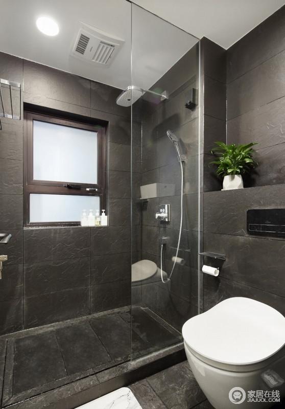 卫生间以深灰色砖石铺贴墙面,构成庄重大气,玻璃淋浴间解决了干湿的问题,让沐浴更为私密,也易于打理。