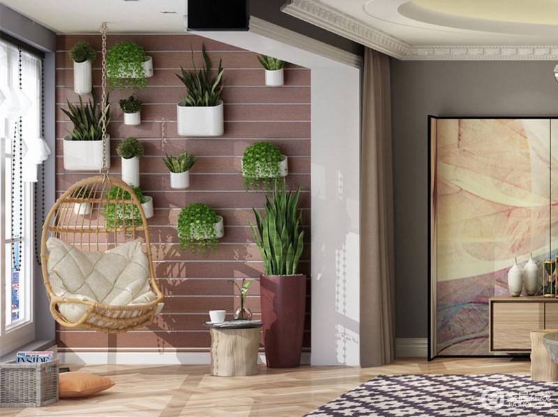 阳台拥有大落地窗,带来充足的光线。墙面上做了复古红砖色调,壁挂各种绿植,使阳台一隅充满了自然氧气。一把悬挂式蛋椅,更添休闲的随性舒适。