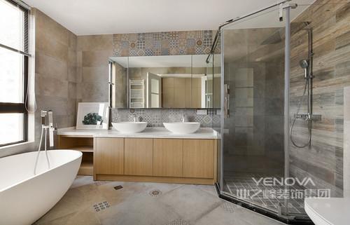 卫生间利用玻璃将浴室一分为二,干湿分开,可保持沐浴之外的干燥,维持整体环境的整洁;浅灰色砖石的粗粝感颇具原始气息,而盥洗区墙面以拼花砖来张扬一种艺术,搭配原木盥洗柜、圆形台盆,让生活格外精致。