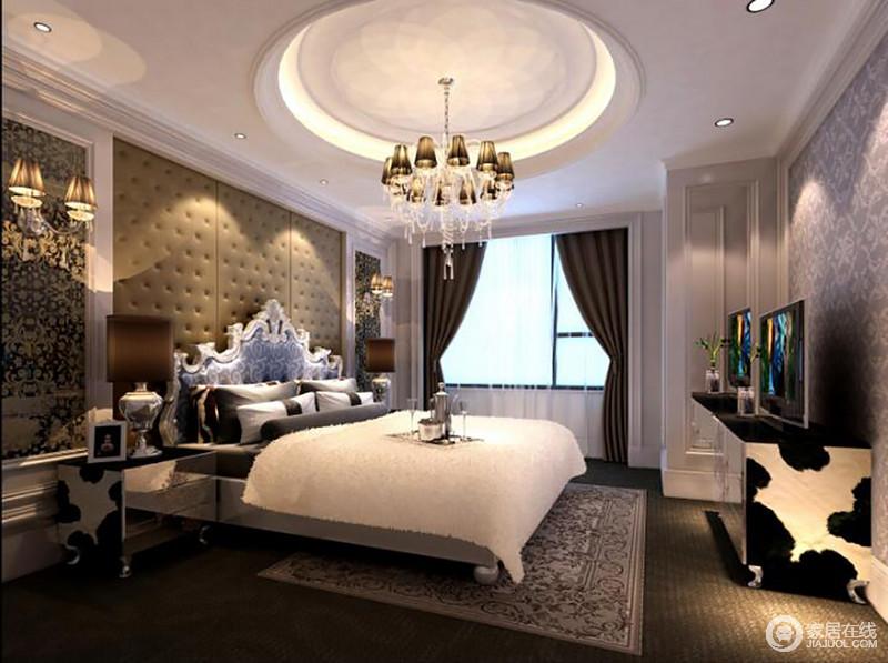 卧室采用圆形的吊顶使空间更加生动、丰富,与方形背景墙构成方圆之美;白色与深灰色组合既沉稳又耐看,而欧式家具的金属雕刻工艺与陈列设计,足以彰显奢华。