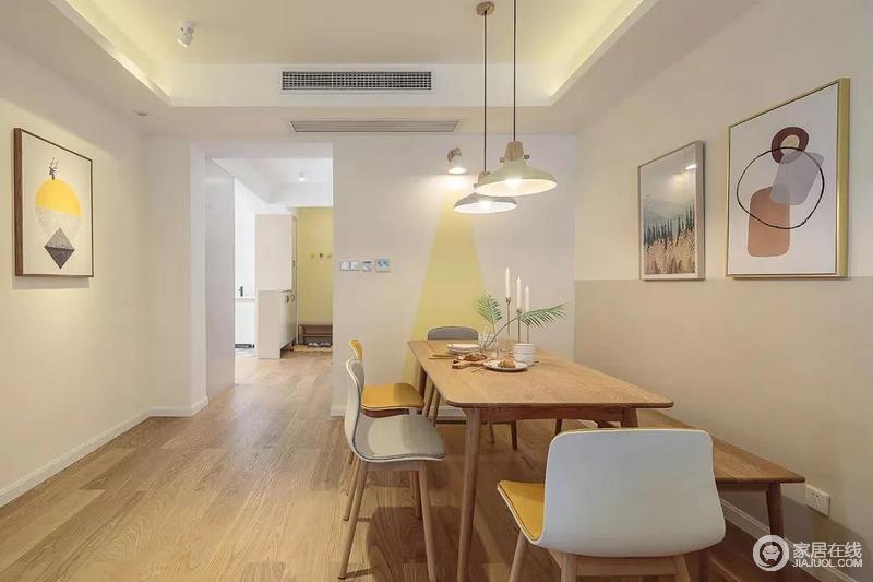 玄关处进门就到了餐厅空间,餐桌椅的侧方墙面做了几何形的黄色图案,另一侧是把墙面分成了两半,增加餐厅的空间层次,同时,搭配简约风的灯饰和桌椅,造就轻简干练。