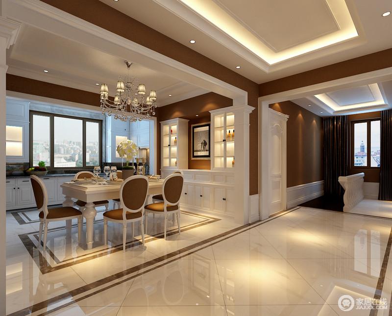 餐厅充分利用墙面设计,将酒柜与西厨以环绕型方式,增加空间的强收纳功能;深咖与简白的搭配,也使空间与空间和谐统一;华美的水晶灯悬挂在餐桌上,白色的餐桌透着欧式的典雅,配上圆靠背咖白餐椅,端庄又高贵。