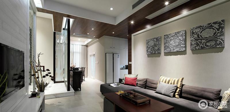 客厅和餐厅为一个整体,纵深较长,通过吊顶和墙壁的不同设计来进一步明确两个不同的功能区域。