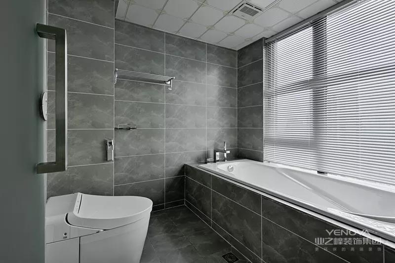 主人卫生间的木色洗手盆柜,搭配嵌入式的台上盆,还有灰色的墙面砖,营造出一个简约自然的卧室氛围感。