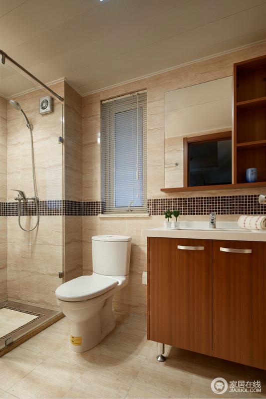 卫生间线条简洁利落,再加上米色细纹砖石铺贴,更是营造了暖和与平直感;玻璃淋浴房干湿分离的设计,让生活足够舒适,浅胡桃色的盥洗柜搭配收纳柜,让生活足够实用。